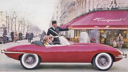 A stylish couple in their Series 1 Carmen Red 3.8 E-Type Jaguar, hoping for a glimpse of François Truffaut or Jean-Luc Godard, are informed that sidewalk parking on the Champs-Élysées in front of Brasserie Fouquet's is not possible