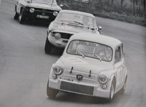 Two Alfa Giulias pursue a 1000 Corsa; 1967
