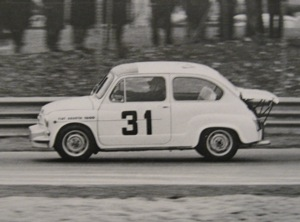 The iconic profile at speed: The 1000 Corsa with fiberglass radiator shroud and extended engine lid