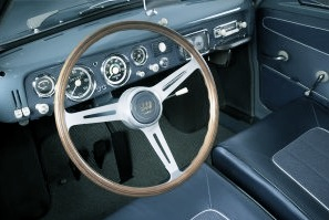 Saab GT 750 Cockpit with wood-rimmed aluminum steering wheel, circular instruments, large tachometer and factory-fitted Halda Speedpilot