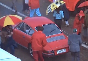 Rear wiper on a Stuttgart-registered 1968 A-Series 911S captured in action during early afternoon rainfall in the paddock during the 24 Heures du Mans, June 1970. As seen in the film Le Mans, 1971