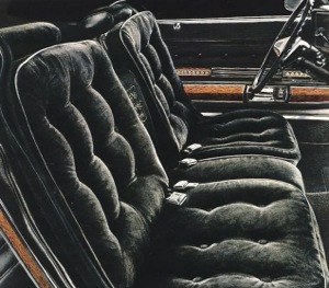 "1974 Oldsmobile 98 Regency: Black Velour, ""Pillow-Look"" cushions and gold embroidered filigree."