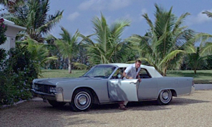 Bond alights from his 1965 Continental Convertible in Nassau for lunch with Emilio Largo. At the time, the Continental was the world's only mass-produced four door convertible.