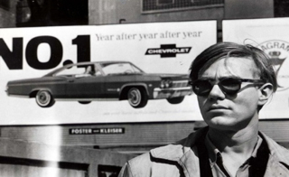 From mid-1964 to mid-1965, British photographer David McCabe followed Andy Warhol around as part of a documentary project. In the spring of '65 Andy stopped to pose in front of one of Jim's billboards. David McCabe photo, 1965