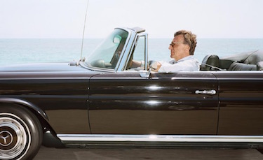 Man cruising south-southeast at 65 mph on Highway 101 near Toro Canyon on June 19th as the tide is coming in, 2010