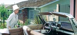 Lana Tuner prepares to depart in her Fawn Beige '61 Plymouth Fury with Dark Copper interior. Note the TV-tube shaped clear acrylic steering wheel rim.