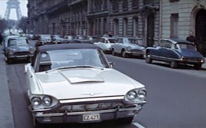 Largo parks his new Thunderbird on Avenue d'Eylau across from the global headquarters of SPECTRE in the prestigious 16th arrondissement, Paris.